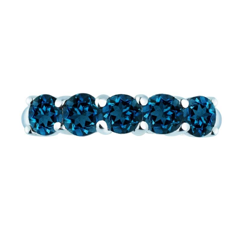 Stacking ring set five gorgeous oval-shaped London Blue Topaz