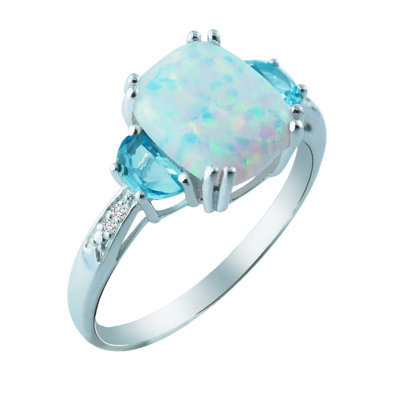 Beautiful Created Opal and Moon Cut Swiss Blue Topaz ring