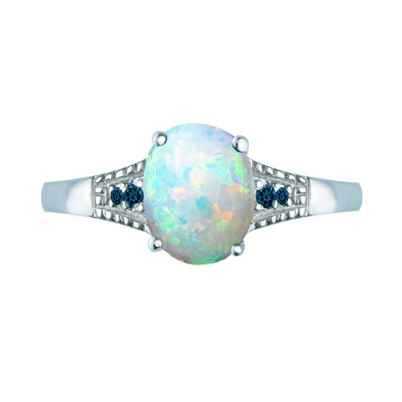 Oval-Shaped Created Opal ring with London Blue Topaz on side