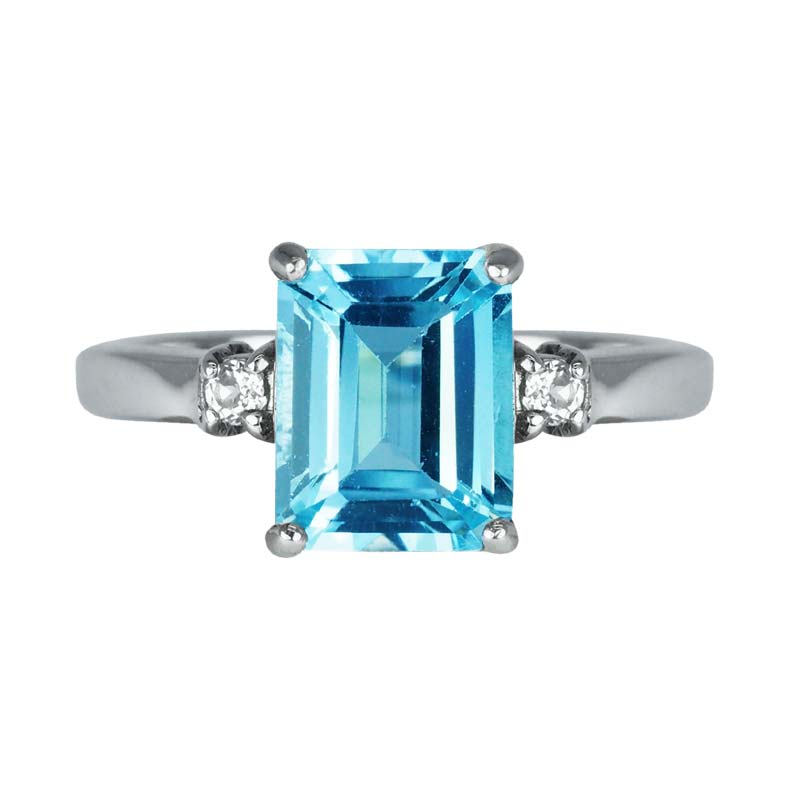 Emerald cut Swiss Blue Topaz ring with White Topaz on sides