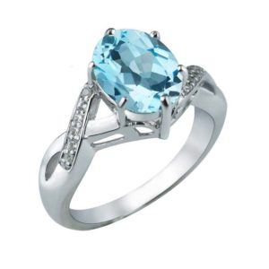 Oval-shaped Natural Sky Blue Topaz ring with Diamonds