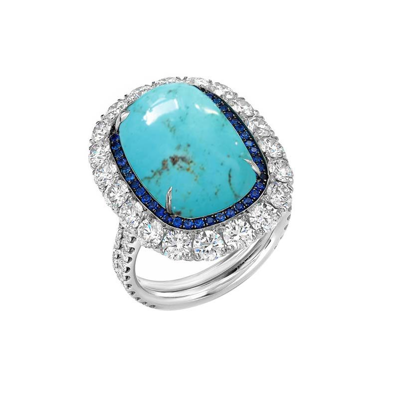 Turquoise Ring framed by dark Blue Created Sapphires and Cubic Zirconia