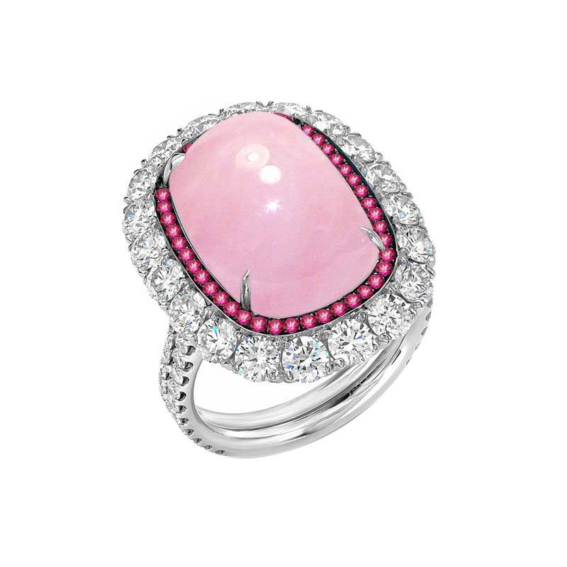 Sterling Silver Rose Quartz ring framed by Pink Topaz and Cubic Zirconia