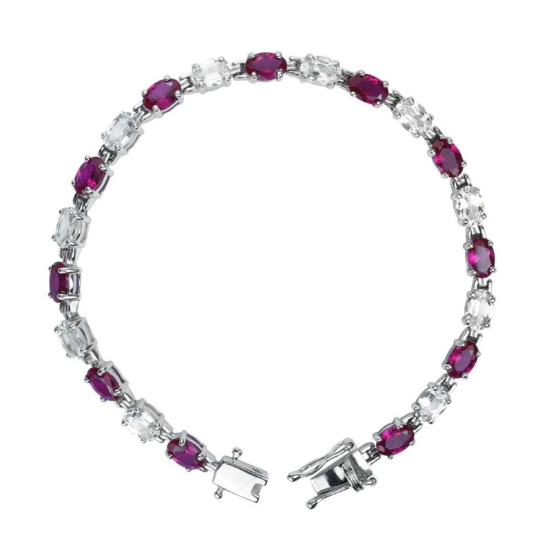 oval shaped lab grown ruby and white topaz tennis bracelet