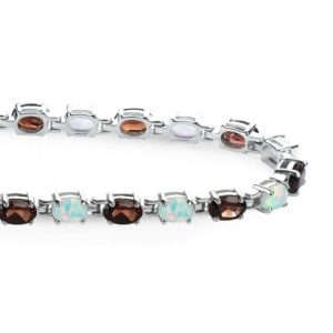 garnet and created opal oval shaped tennis bracelet